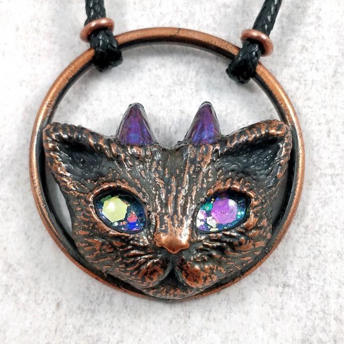 bijou cuivre chat démon cornes cercle yeux étoiles